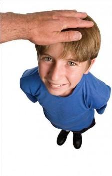 Hand patting boy's head