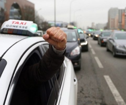 Taxi protest in Paris turns to guerrilla warfare as Uber car attacked on freeway